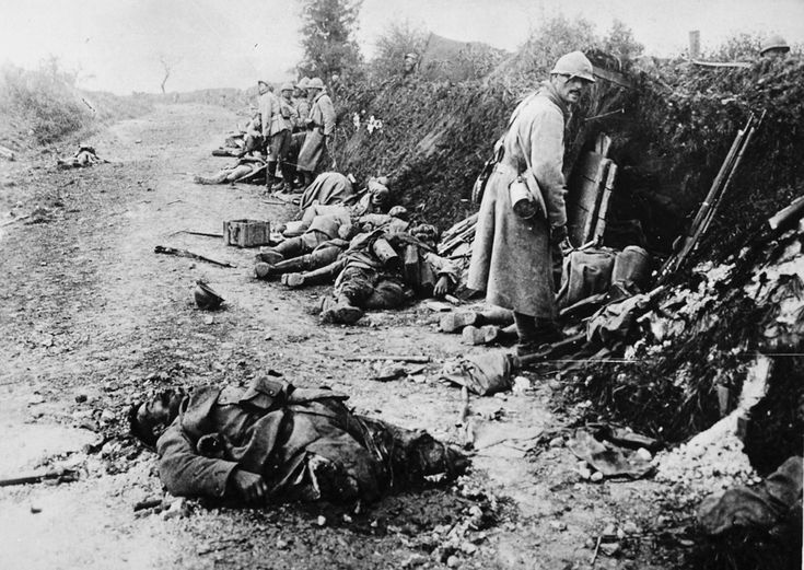 French soldiers, some wounded, some dead, after the taking of Courcelles, in the department of Oise, France, in June of 1918.