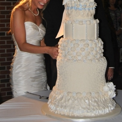Ivory wedding cake By Tjensen on CakeCentral.com. Holy crap that's a big cake!!!