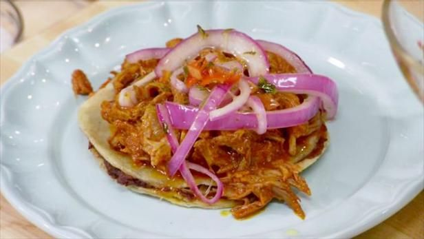 Get Shredded Pork and Bean Panuchos with Pickled Habanero and Onions (Cochinita Pibil) Recipe from Food Network