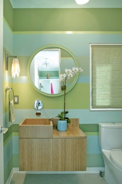 Use color in the bathroom! Love to different stripe sizes, the color, and the floating wood sink/cabinet too!