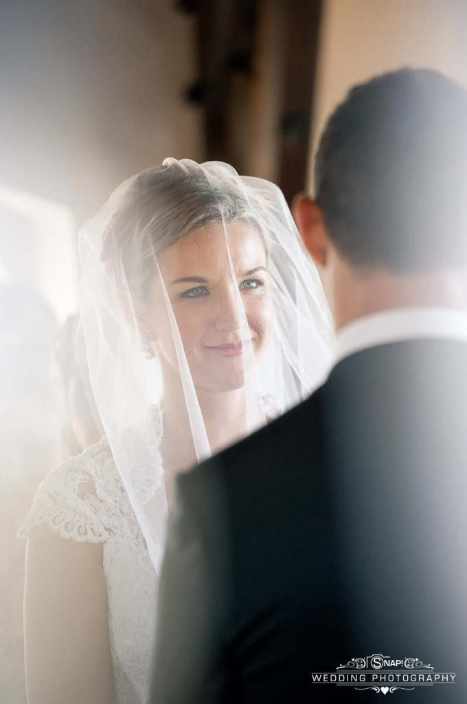 A beautiful photo of the bride, as she looks lovingly at the groom. Check out other wedding photography by Anthony Turnham at www.snapweddingphotography.co.nz