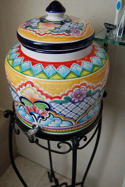 A talavera water dispenser. Everyone drinks bottled water and the pottery keeps it cool.