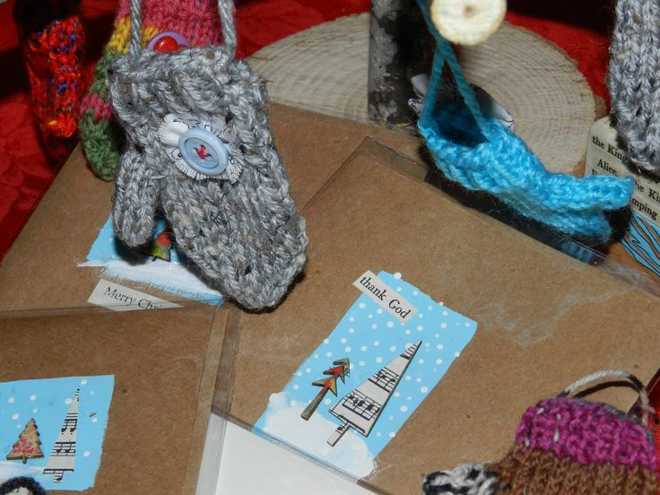 Hand knit holiday Christmas decorations and mixed media cards by M. Hebert.