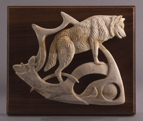 carved antler, not wood but still awesome