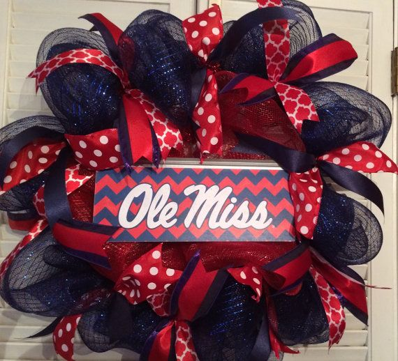 Ole Miss Rebels fans need a proper door decoration. This handmade wreath is made of navy and red deco mesh, a licensed tin Ole Miss sign (12x5) and