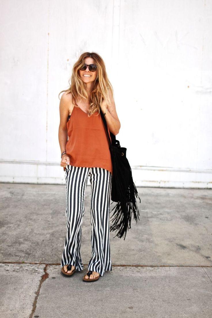 Loose striped pants, tank top, fringe bag and birkenstocks.