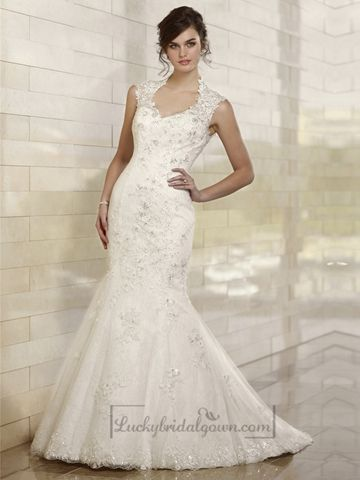 Trumpet wedding dress in Lace features a scalloped keyhole back, crystal buttons and embellishments on embroidered lace throughout the fitted bodice and flared skirt. Scalloped lace edging finishes the already elegant chapel train.