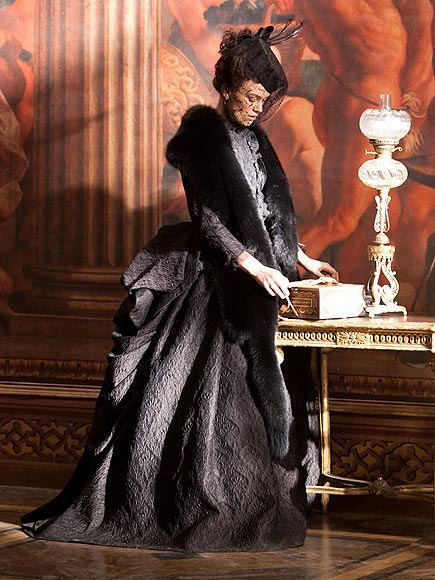 Keira Knightley in Anna Karenina wearing a black brocade dress with matching fur stole and pillbox hat with veil