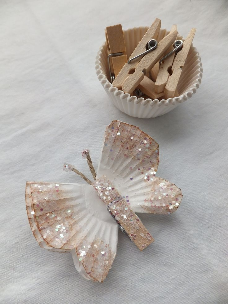 Cupcake Liner Butterflies.  Beautiful, simple craft.  I intend to make them and cover our Christmas tree with them.