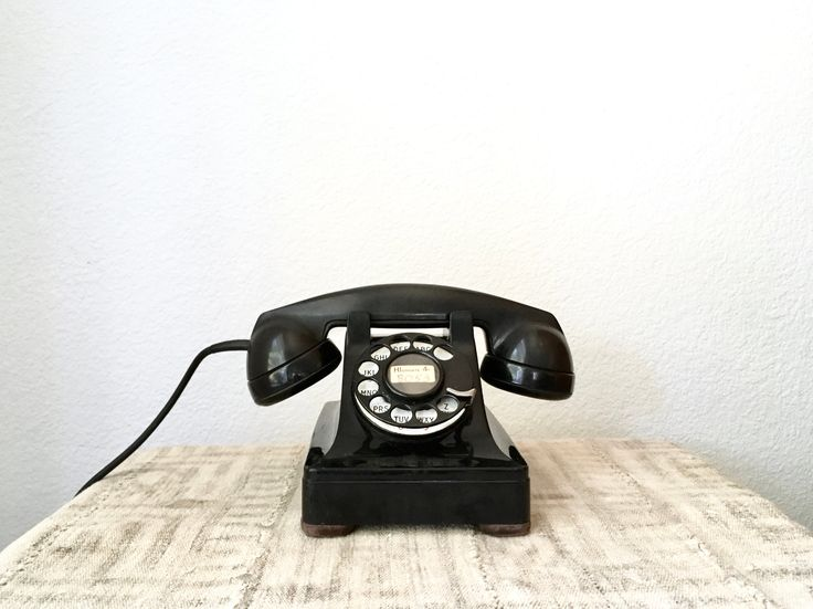 This super fabulous example of a 1940s Western Electric F1 rotary phone would make a PERFECT play prop, or if restored could be a great landline phone. It displays its original old school phone number, HI 4-8053. Rad.It has not been tested, as the cord is cut. A new plug would need to be put on.Both the handset and the body are bakelite. The handset reads:Bell SystemManufactured ByWestern Electric CompanyF1The dial face is a nice bright white with black let...