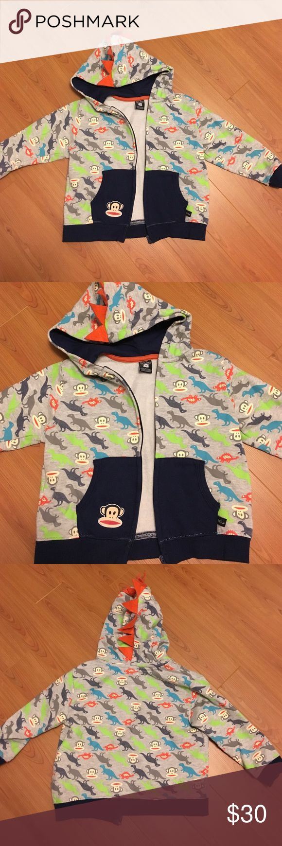Paul Frank dinosaur hoodie An original Paul Frank hoodie for toddler boys. Has monkey faces and pictures of dinosaurs all over. Hood itself has orange dinosaur spikes to add to the effect. Paul Frank Shirts & Tops Sweatshirts & Hoodies