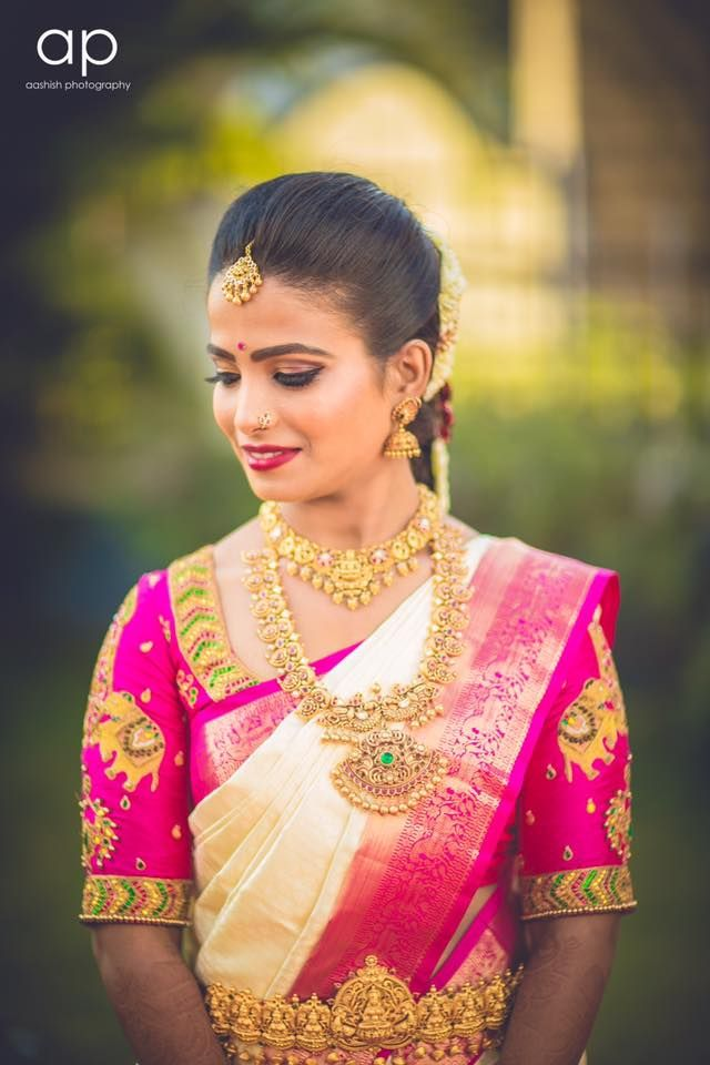 Sudha looks ravishing for her muhurtam. Makeup and hairstyle by Vejetha for Swank Studio. Berry lips. South Indian bride. Eye makeup. Bridal jewelry. Bridal hair. Silk sari. Bridal Saree Blouse Design. Indian Bridal Makeup. Indian Bride. Gold Jewellery. Statement Blouse. Tamil bride. Telugu bride. Kannada bride. Hindu bride. Malayalee bride. Find us at https://www.facebook.com/SwankStudioBangalore