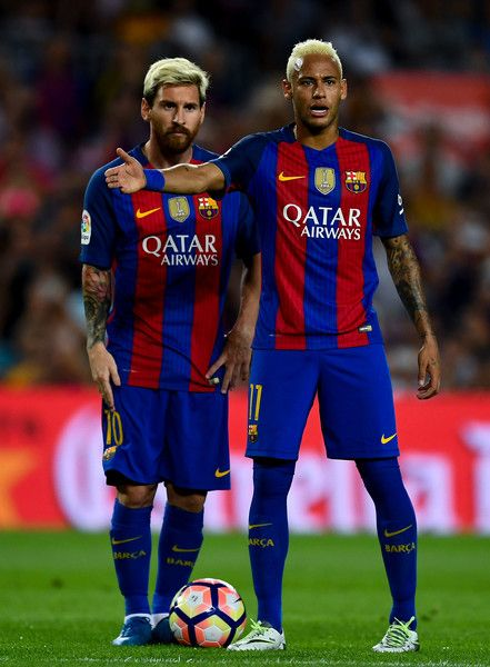 Lionel Messi (L) and Neymar Jr. of FC Barcelona reacts during the La Liga match between FC Barcelona and Deportivo Alaves at Camp Nou stadium on September 10, 2016 in Barcelona, Catalonia.