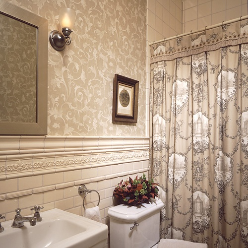 A custom toile shower curtain is perfect in this ornate Victorian bath
