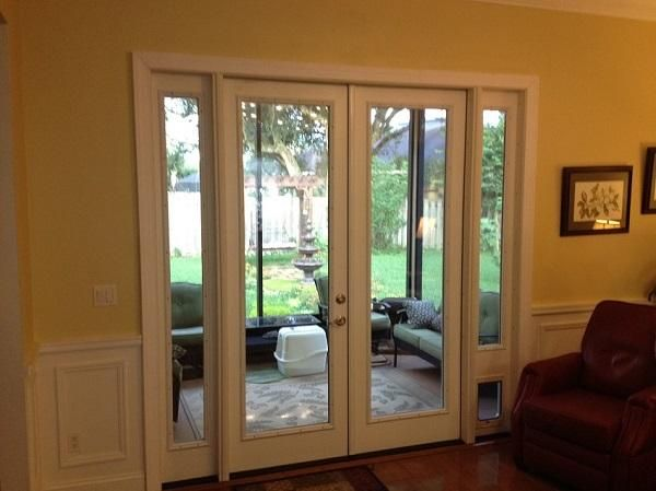 This was a sliding glass door unit. Homeowners wanted french doors and needed a pet door and thought that there was no way it could happen.. We came to the rescue!