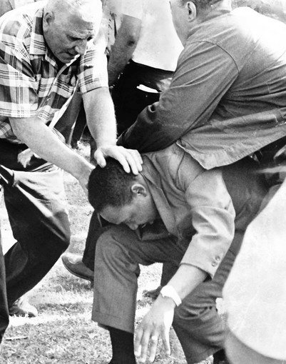 """In 1966 Martin Luther King Jr. was stoned (a thrown rock struck him in the head) during a March he lead (of about 700 people) in Marquette Park on Chicago's Southwest Side. The civil-rights leader and his supporters were in the white ethnic enclave to protest housing segregation practices. Approx 30 others were injured along with Dr King. He later explained why he put himself at risk: """"I have to do this--to expose myself--to bring this hate into the open."""""""