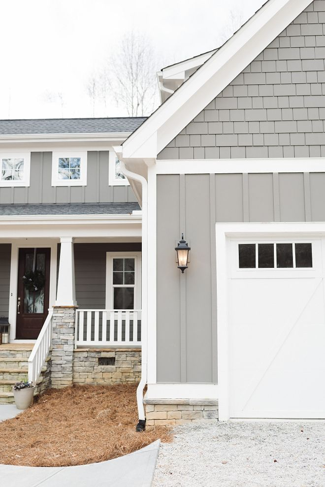 Grey siding paint color is Gauntlet Gray Sherwin Williams and white trim paint color is Snowbound by Sherwin Williams. +Hale navy shutters