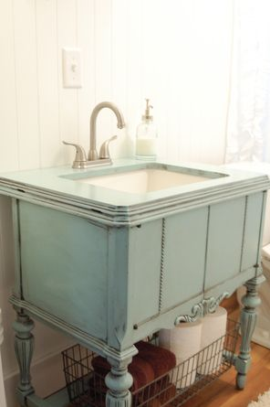 A repurposed sewing machine cabinet is now a bathroom vanity. This looks great! I need this in my new laundry room!