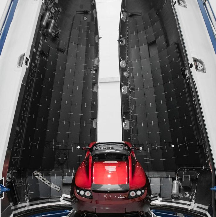 "Earlier in December, SpaceX CEO Elon Musk said that the first flight of the company's Falcon Heavy rocket, tentatively scheduled for liftoff next month, would have as its payload a ""midnight cherry Tesla Roadster playing Space Oddity."" Earlier this week, Musk tweeted photos of the Falcon Heavy gettin"