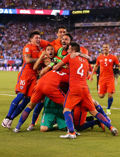 #COPA2016 #COPA100 Claudio Bravo of Chile is mobbed by his teammates after defeating Argentina to win the Copa America Centenario Championship match at MetLife Stadium...