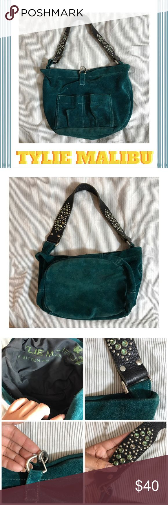 💙💚TYLIE MALIBU suede hobo 💙💚 What a gem ! Authentic TYLIE MALIBU real suede hobo 💚💙 embellished leather straps give it a boho rocker feel that demands attention ! Definitely loved with some dry cleaning needs . Priced accordingly ✌🏼 Tylie Malibu Bags Hobos