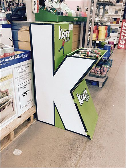 """The letter """"K"""" as freestanding corrugated Dimensional Display makes for perfect brand reinforcement as well as attention compeller for this Krazy Glue® Point-of-Purchase promotion. Brand is further..."""