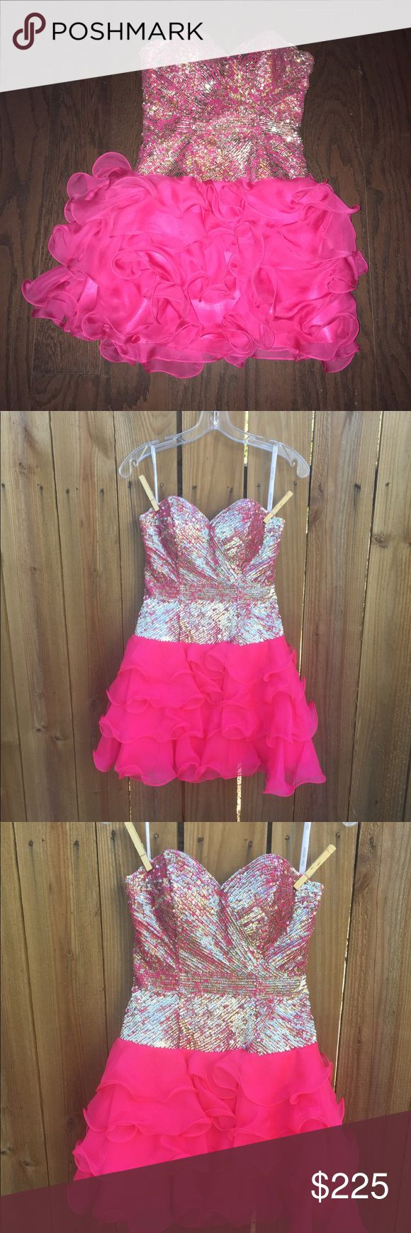 sherri hill prom Or Coctail Dress Size 2 Only worn once, this strapless beauty is in like new condition! It zips up under one arm. Has tulle under the skirt to create the flair in the skirt that complements the fitted bodice. Sherri Hill Dresses Strapless
