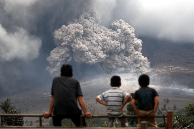 Mount Sinabung releases pyroclastic flow during an eruption in Berastepu, North Sumatera, Indonesia