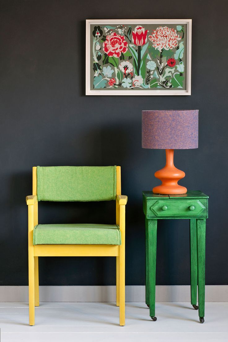 Antibes Green painted side table with Barcelona Orange painted lamp base. English Yellow & Antibes Green Annie Sloan Coloured Linen Fabric on the English Yellow painted chair all set against a wall painted in Graphite Wall paint.
