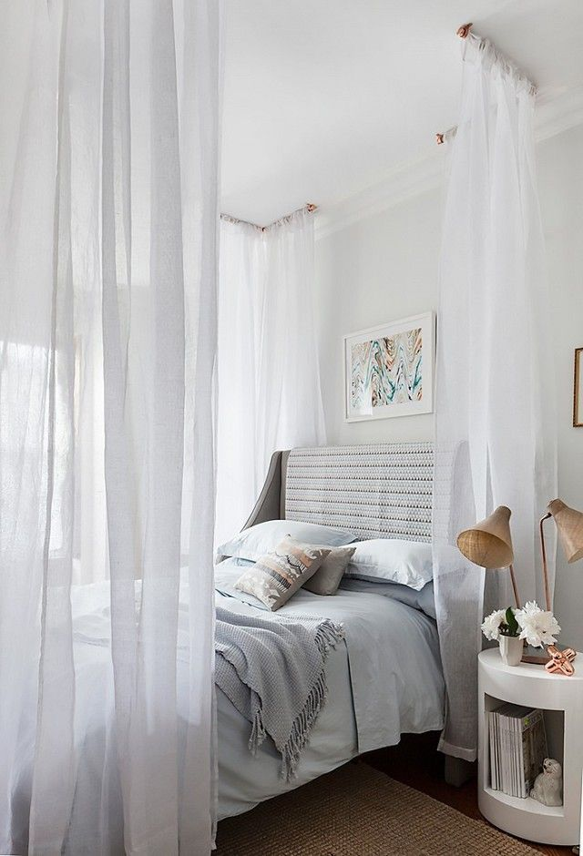 Pro tip: When trying to refresh your décor try    re-covering your old headboard with a throw blanket to give your bedroom a cost-free upgrade.
