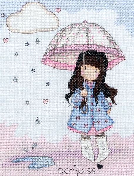A cute picture of a little girl in raincoat with umbrella in the rain.