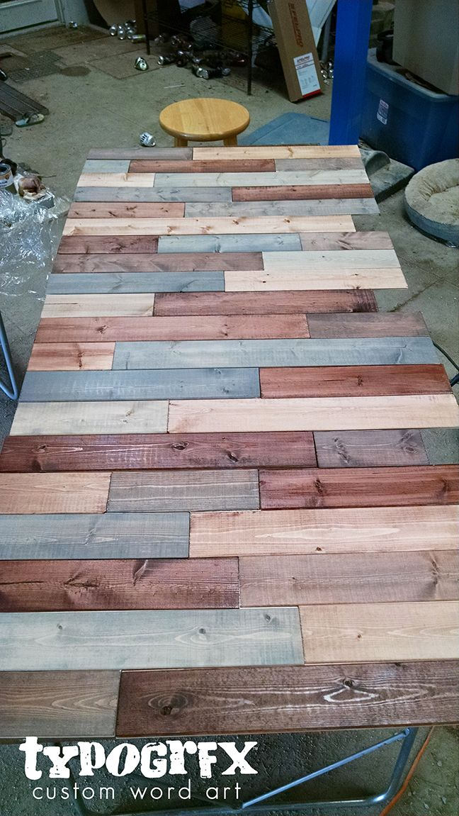 All boards cut and stained for faux pallet wall to be installed in TYPOGRFX mobile boutique truck. Full tutorial on blog.