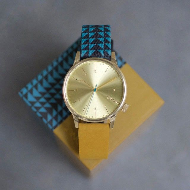Winston Galore Triangle Teal. Mixing graphical elements with poppy colors and a nice suede leather strap. You're welcome.