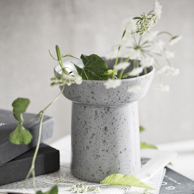 The popular Ombria stoneware range is designed by Anders Arhøj. With its innovative glaze and the simple idiom, the range is inspired by the rough, wild Scandinavian countryside. The small Ombria vase from Kähler comes in four lovely shades that evoke long coastlines, birds' eggs and craggy rocks. Use the slate grey vase alone or incorporate it into your personal design tableau.