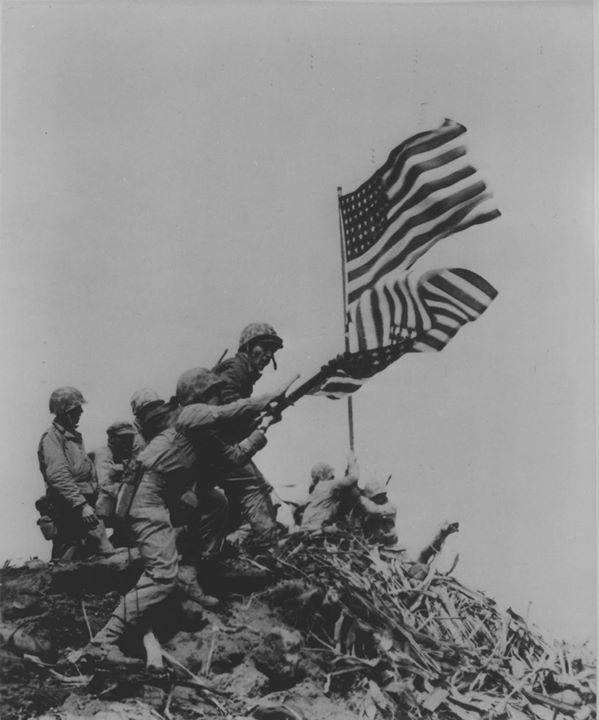 US Marines removing the first Mount Suribachi flag as the second flag was being raised Iwo Jima Japan 23 February 1945.