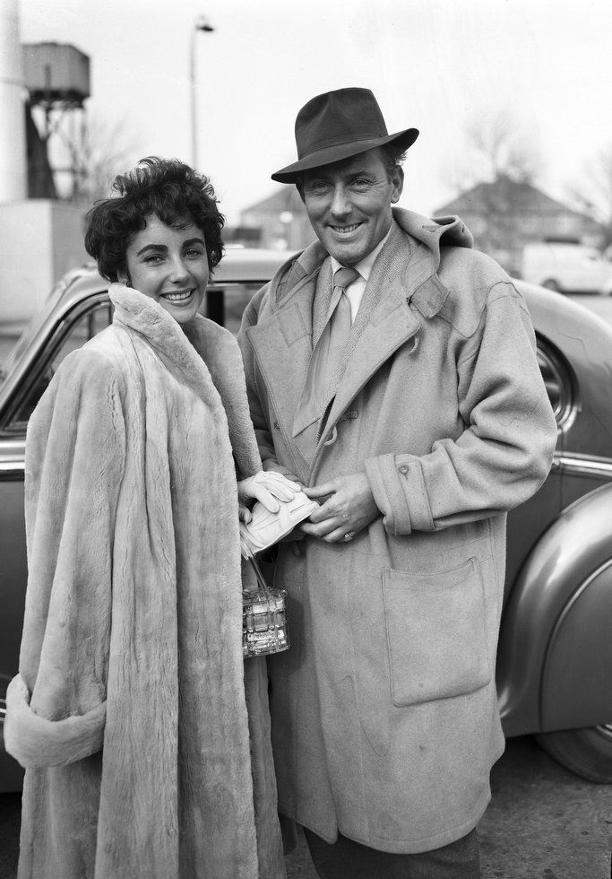 Actress Elizabeth Taylor and her husband Michael Wilding return from their honeymoon in the Swiss Alps, at London Airport, London, March 3, 1952. (AP Photo/Eddie Worth)