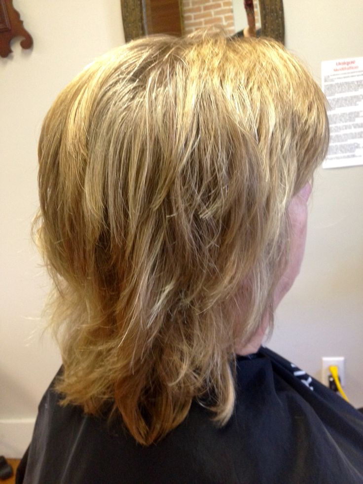A Medium Length Hair Cut With Lots Of Layers For Texture