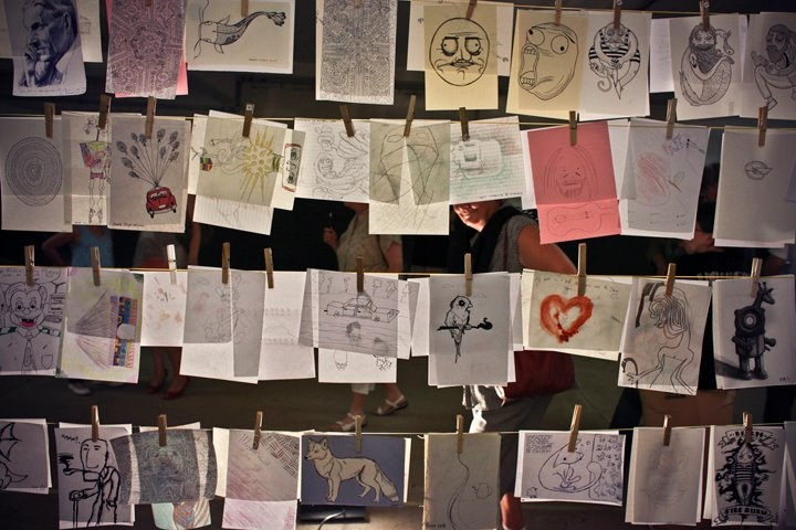 Donated drawings all lined up for lucky buyers hoping to snap up an undiscovered star.  Night of a 1000Drawings, Johannesburg 2011.