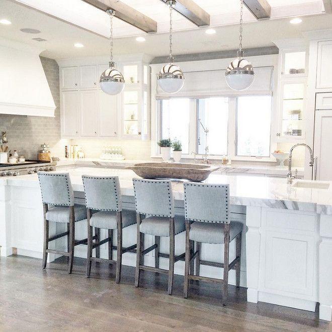 Kitchen island with three Hicks pendants Caitlin Creer Interiors