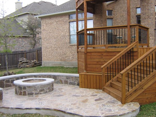 Build deck on top of pergola bench retaining wall for Fireplace on raised deck