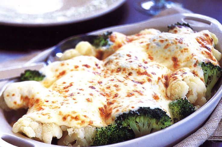 Sprinkle parmesan cheese over this creamy cauliflower and broccoli bake and finish it under the grill for a crisp, golden topping.