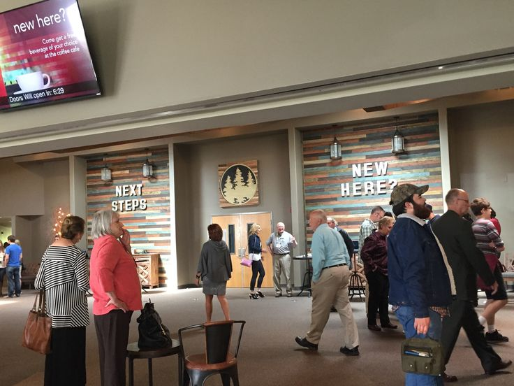 "Westwood Baptist lobby- love the wood wall tones & how they draw attention to the ""welcome/info centers"""