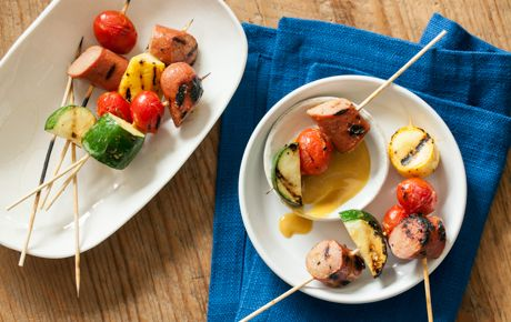 Adults and kids alike will fall for these summer skewers, threaded with fresh zucchini, cherry tomatoes and beef hot dogs, and basted with honey mustard.