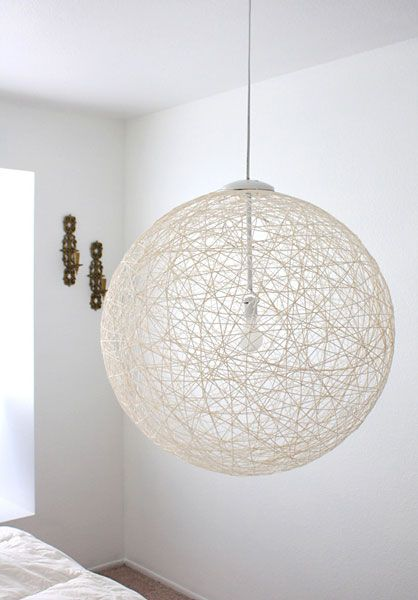 string pendant light. Just got the idea to spray paint it lightly with gold (my latest color obsession) after it dries, think it would be pretty. Might use a different color, though white would look good too.