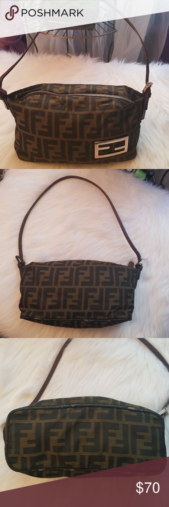 💕Fendi Baguette Canvas  Bag💋Aunthenic ✔ Gorgeous Bag used/ still has tons of life with in....flaws are peeling along side of bottom of bag that are not noticeable while wearing the strap has a little wear see photo's! Fendi Hardware in Excellent condtion /No stains  Great Bag just need a little repair... dimensions are 10 across 5 down.. Price reflects Flaws✔ Fendi Bags Shoulder Bags