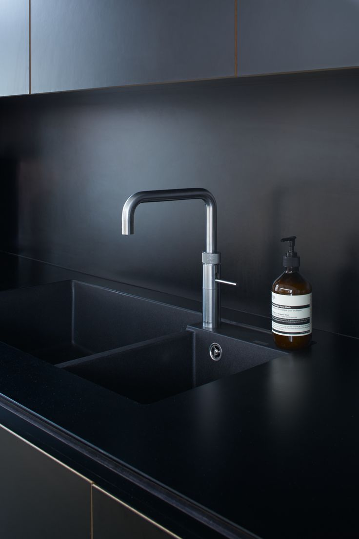 Worktop & splashback are both Diamond Black Matt Formica along with Formica doors with visible birch ply edging. The sink is a Blanco Metra 9 in anthracite finish and the tap is a Quooker PRO3 Fusion Square in brushed chrome.