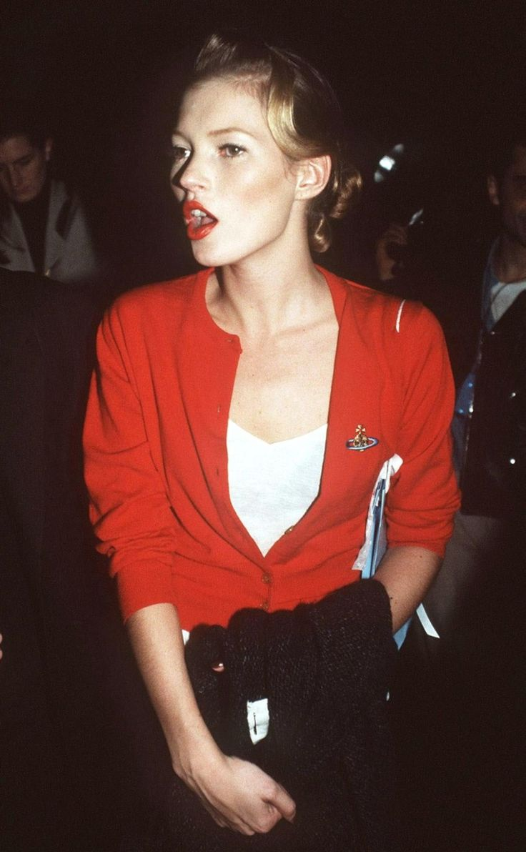 Red cardie + red lips. Kate Moss in Vivienne Westwood, 1990's.