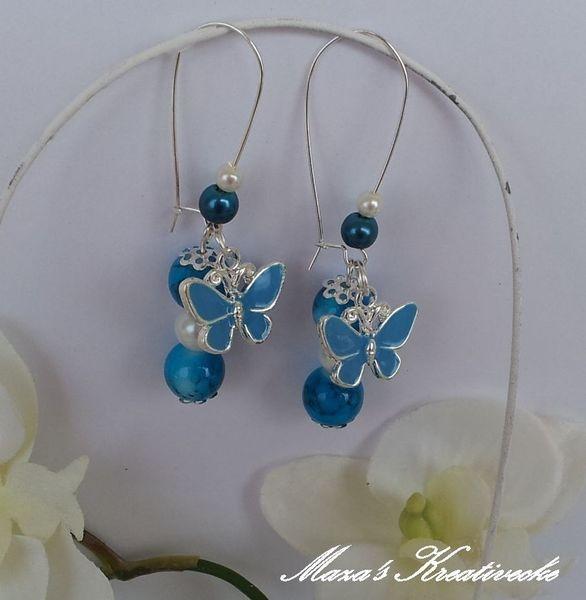 Du+erhälst+1+Paar+zauberhafte+Ohrhänger+Butterfly.+Süße+Schmetterlinge+hängen+neben+aufgezogenen+Perlen.  Geringe+Farbabweichungen+zum+Bild+sind+mö...