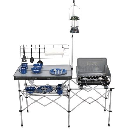 To hang utensils and paper towel, it comes with a steel grate back rack with hooks, while its steel grate bottom rack offers storage space or can be used as a drying rack for dishes. When it's time to go home, the Compact Camp Kitchen folds flat for easy storage and transport. Other features includes a side stove table and a lantern pole. Pick one up for $99.95.