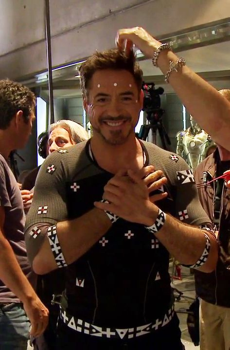 """Robert Downey Jr. getting motion-capture dots applied for the opening workshop scene in """"Iron Man 3"""""""